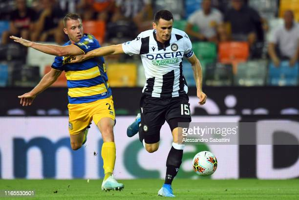 Simone Iacoponi of Parma Calcio competes for the ball with Kevin Lasagna of Udinese Calcio during the Serie A match between Udinese Calcio and Parma...