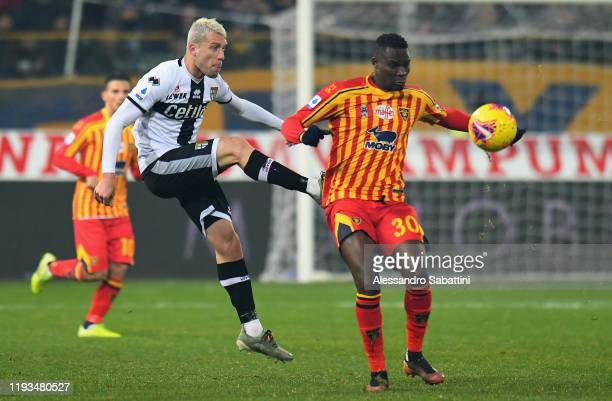Simone Iacoponi of Parma Calcio competes for the ball with Khouma Babacar of US Lecce during the Serie A match between Parma Calcio and US Lecce at...
