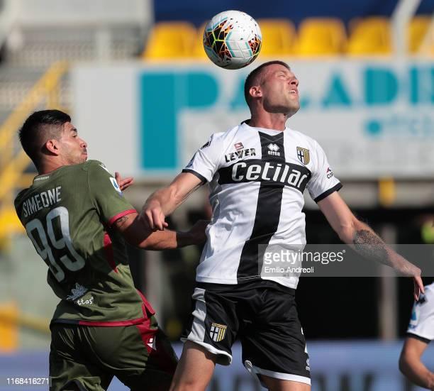 Simone Iacoponi of Parma Calcio jumps for the ball against Giovanni Simeone of Cagliari Calcio during the Serie A match between Parma Calcio and...