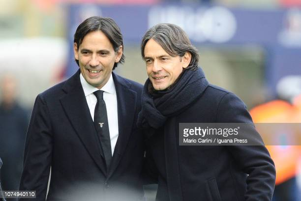 Simone Inzaghi head coach of SS Lazio and brother Filippo Inzaghi head coach of Bologna FC look on prior the beginnng of the Serie A match between...