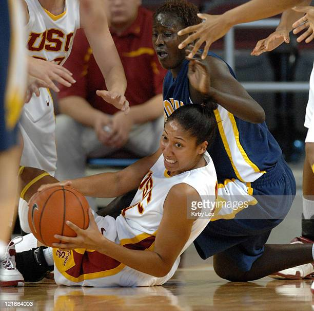 Simone Jelks of USC battles for loose ball with Rama N'diaye of California during Pacific-10 Conference women's basketball game at the Galen Center...
