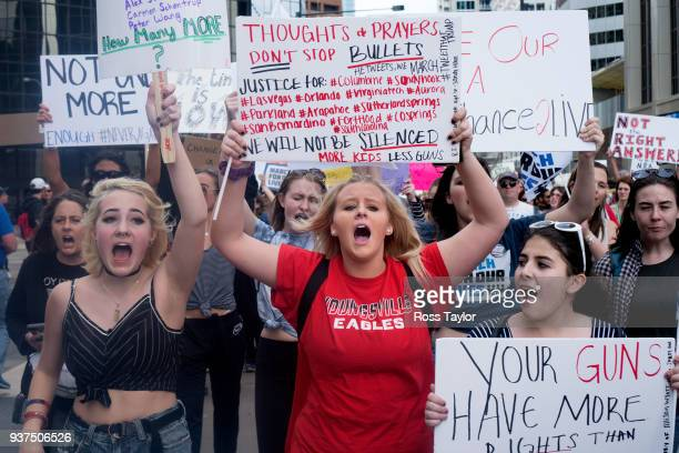 Simone Kirkevold of Longmont Colorado Lexi Ames of Denver and Laura Mendoza of Denver shout 'This is what democracy looks like' during the March for...