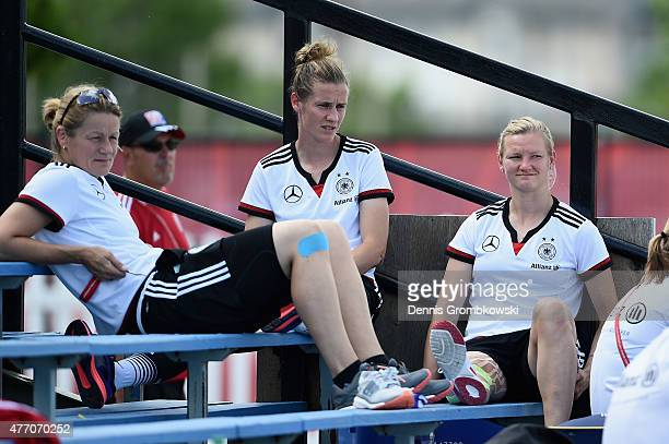 Simone Laudehr and Alexandra Popp of Germany sit besides the pitch as they suffered an injury during a training session at Waverley Soccer Complex on...