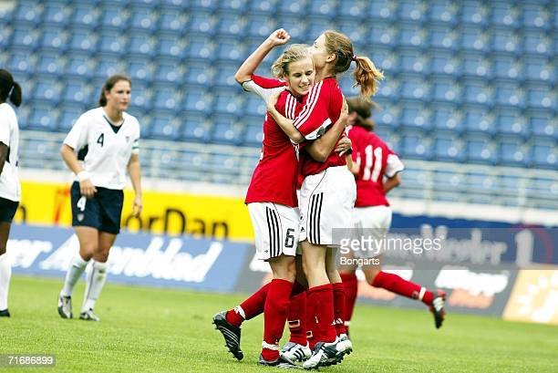 Simone Laudehr and Shelly Thomson of Germany celebrate during the Women's U21 Nordic Cup final between Germany and USA at the Viking Stadium on July...
