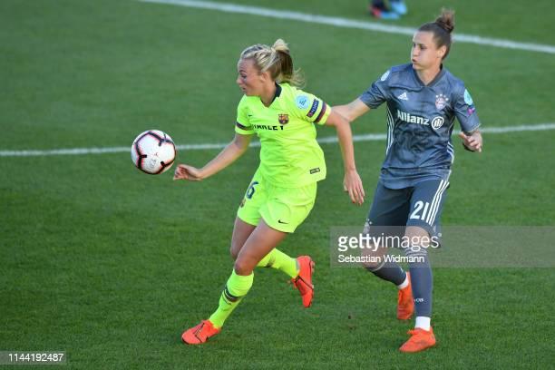 Simone Laudehr of Bayern Munich challenges Toni Duggan of Barcelona for the ball during the UEFA Women's Champions League semi final first Leg match...
