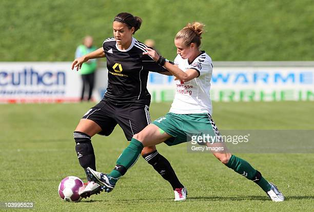 Simone Laudehr of Duisburg challenges Dzenifer Maroszan of Frankfurt during the Women's bundesliga match between FCR Duisburg and FFC Frankfurt at...