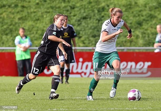 Simone Laudehr of Duisburg challenges Meike Weber of Frankfurt during the Women's bundesliga match between FCR Duisburg and FFC Frankfurt at the...