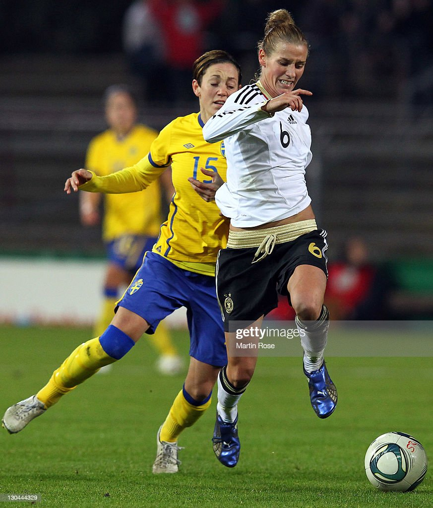 Simone Laudehr (R) of Germany and Therese Sjoegran (L) of Sweden battle for the ball during the Women's International friendly match between Germany and Sweden on October 26, 2011 in Hamburg, Germany.
