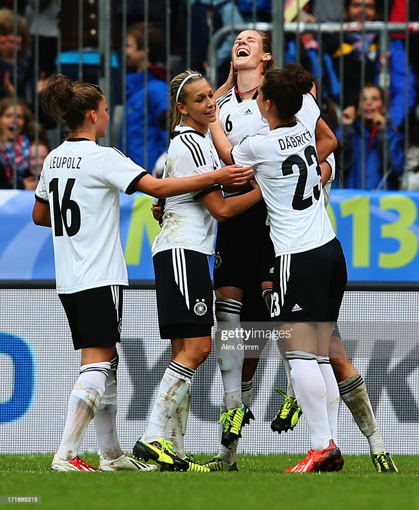 Simone Laudehr (2R) of Germany celebrates her team's fourth goal with team mates during the Women's International Friendly match between Germany and Japan at Allianz Arena on June 29, 2013 in Munich, Germany.