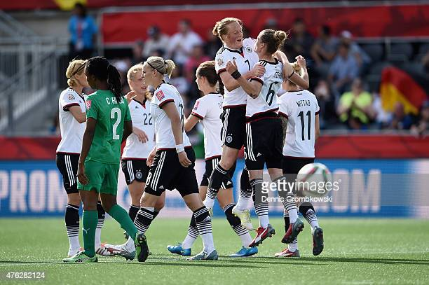 Simone Laudehr of Germany celebrates with team mates as she scores the seventh goal during the FIFA Women's World Cup Canada 2015 Group B match...