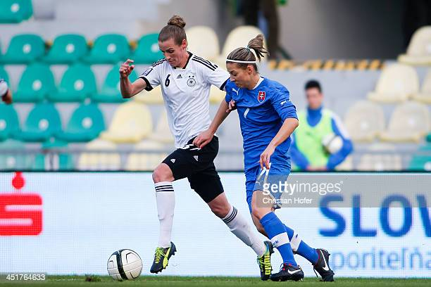 Simone Laudehr of Germany competes for the ball with Patricia Fischerova of Slovakia during the FIFA Women's World Cup 2015 Qualifier between...