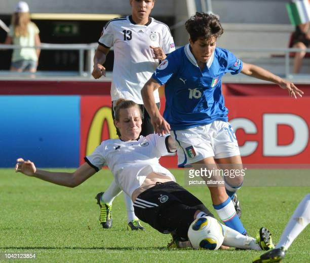 Simone Laudehr of Germany fights for the ball with Elisa Bartoli of Italy during the UEFA Women's EURO 2013 quarter final soccer match between...