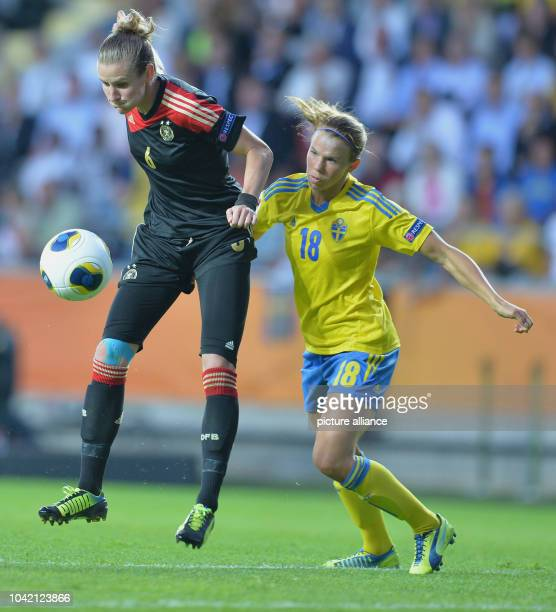 Simone Laudehr of Germany fights for the ball with Jessica Samuelsson of Sweden during the UEFA Women's EURO 2013 semifinal soccer match between...