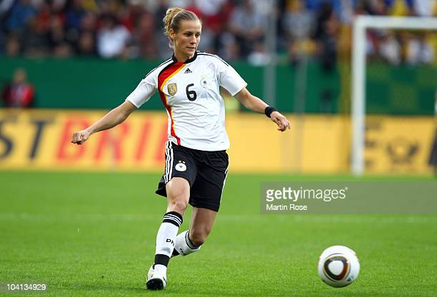 Simone Laudehr of Germany runs with the ball during the Women's International Friendly match between Germnay and Canada at Rudolf Harbig stadium on...