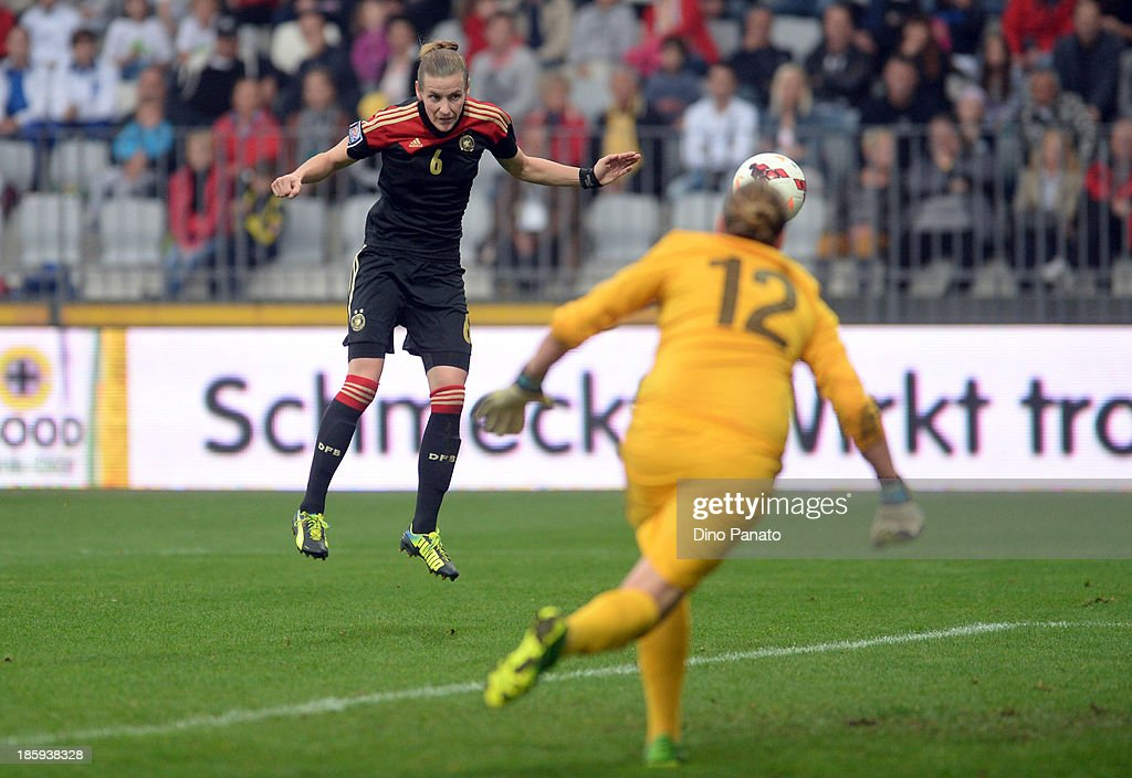 Simone Laudehr (L) of Germany scores a goal during the Qualifying Round - FIFA Women's World Cup between Slovenia and Germany at SRC Bonifika stadio on October 26, 2013 in Koper, Slovenia.