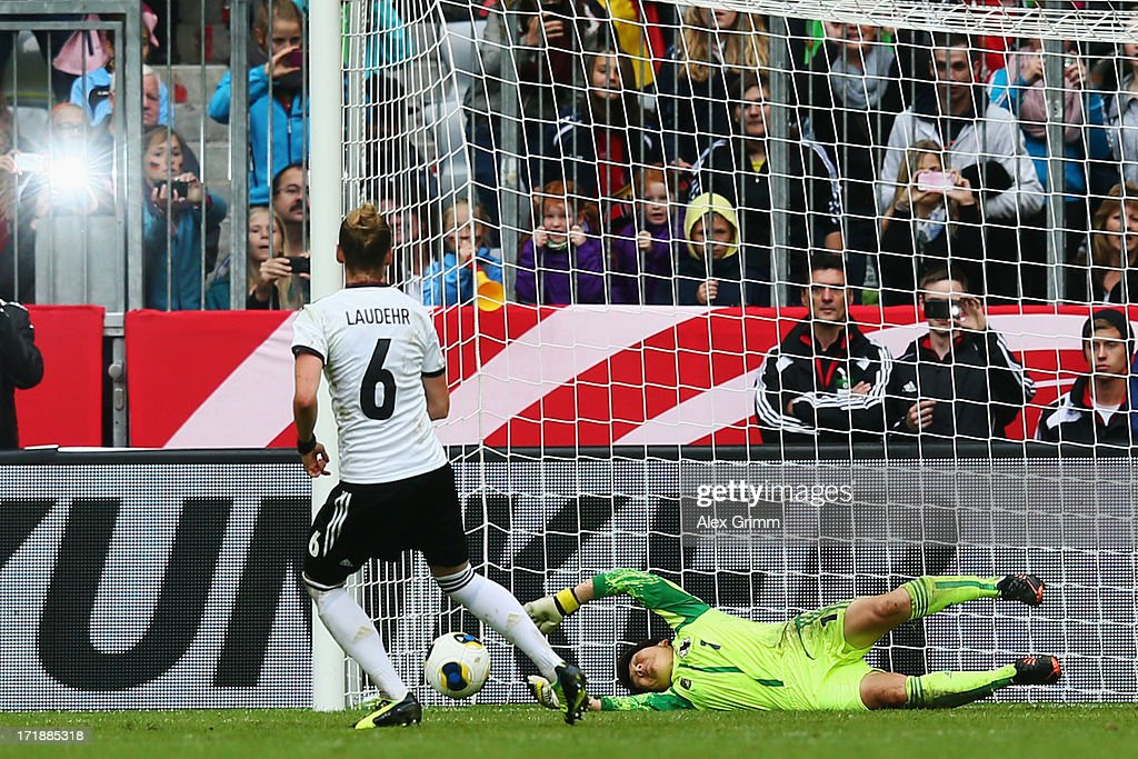 Simone Laudehr of Germany scores her team's fourth goal with a penalty against goalkeeper Miho Fukumoto of Japan during the Women's International Friendly match between Germany and Japan at Allianz Arena on June 29, 2013 in Munich, Germany.