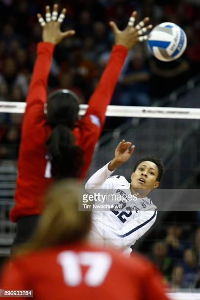 Simone Lee of Penn State University taps the ball past Briana Holman of the University of Nebraska during the Division I Women's Volleyball...