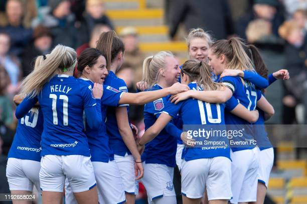 Simone Magill of Everton celebrates scoring her teams first goal with team mates during the Barclays FA Women's Super League match between Manchester...