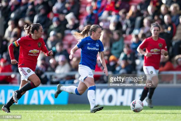 Simone Magill of Everton runs with the ball and his followed by Katie Zelem of Manchester United during the Barclays FA Women's Super League match...