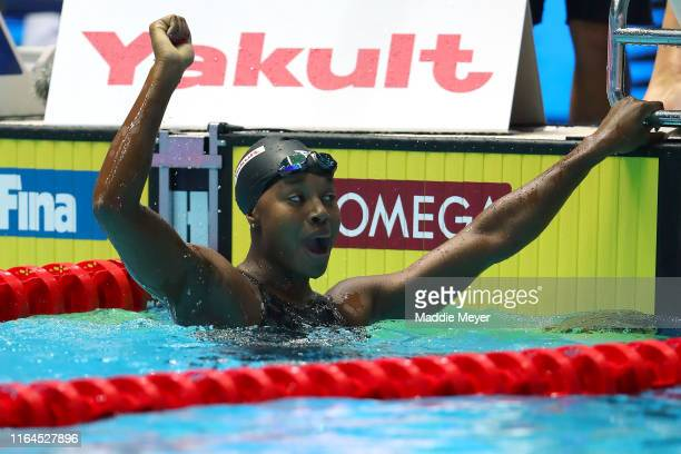 Simone Manuel of the United States celebrates after her team set a new world record of 3:19.40 in the Mixed 4x100m Freestyle Finalon day seven of the...