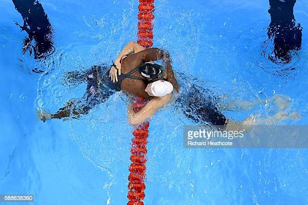 Simone Manuel of the United States embraces Penny Oleksiak of Canada after winning gold in the Women's 100m Freestyle Final on Day 6 of the Rio 2016...