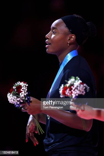 Simone Manuel of the United States reacts during the Women's 50m freestyle medal ceremony during Day Eight of the 2021 U.S. Olympic Team Swimming...