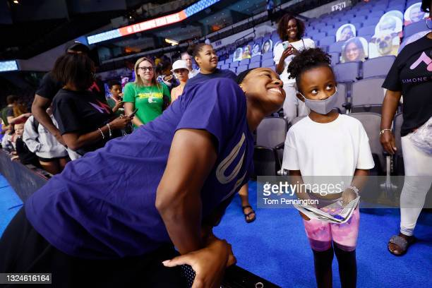 Simone Manuel of the United States takes a picture with a fan during Day Eight of the 2021 U.S. Olympic Team Swimming Trials at CHI Health Center on...