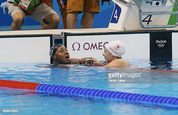 Simone Manuel of United States celebrates his victory egality with Penny Oleksiak of Canada after the final women's 100m freestyle at Olympic...