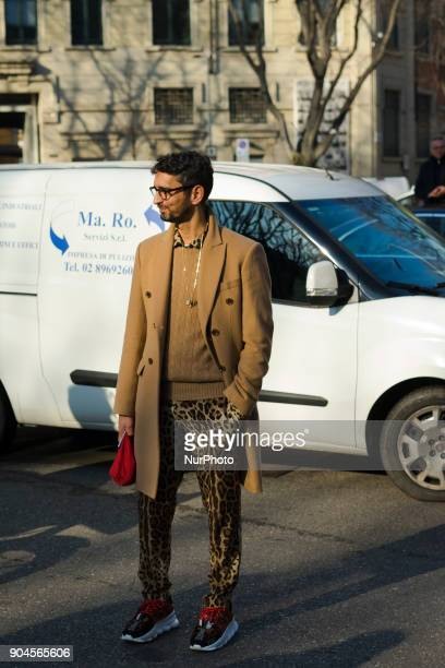 Simone Marchetti is seen on the set of the Armani Advertising Campaign street style during Milan Men's Fashion Week Fall/Winter 2018/19 on January 13...