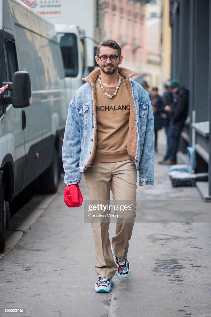 Simone Marchetti wearing denim jacket, beige sweatshirt, beige pants, sneaker is seen outside No21 during Milan Men's Fashion Week Fall/Winter 2018/19 on January 15, 2018 in Milan, Italy.