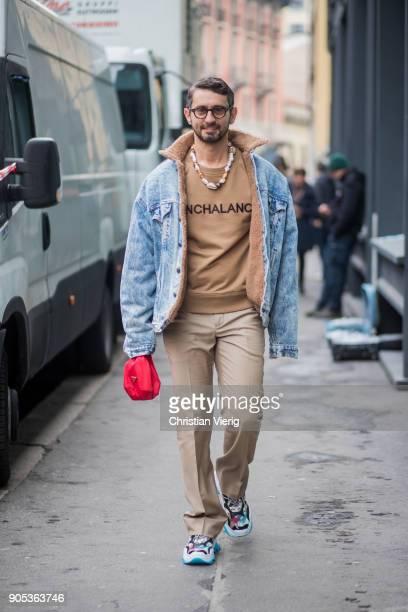 Simone Marchetti wearing denim jacket beige sweatshirt beige pants sneaker is seen outside No21 during Milan Men's Fashion Week Fall/Winter 2018/19...
