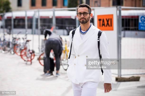 Simone Marchetti wearing white Giorgio Armani suit is seen during the 94th Pitti Immagine Uomo at Fortezza Da Basso on June 14 2018 in Florence Italy