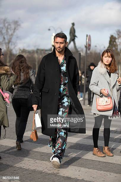 Simone Marchetti wears a black jacket and a printed black pajama style outfit at the Chanel couture show at Grand Palais on January 26 2016 in Paris...