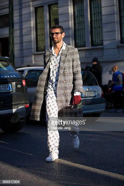 Simone Marchetti wears Dolce Gabbana and Ami Paris by Alexandre Mattiussi gray plaid coat and a white floral print silk pajamastyle top and pants and...