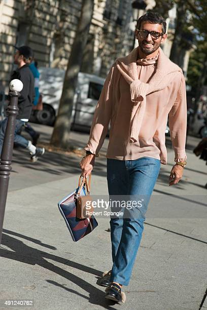 Simone Marchetti wears pink sweater and pink sheer shirt with blue jeans fur lined gucci loafers and Tom Ford glasses after Acne Studios at Hotel...