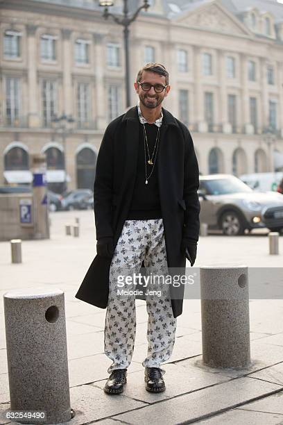 Simone Marchetti wears white flower print silk pants outside the Francesco Scognamiglio show at a ShangriLa hotel on January 23 2017 in Paris France