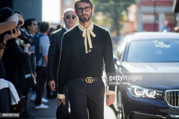 Simone Marchetti with Apple earphones wearing Gucci belt is seen outside Gucci during Milan Fashion Week Spring/Summer 2018 on September 20 2017 in...