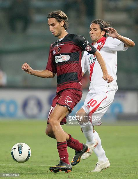Simone Missiroli of Reggina competes for the ball with Luigi Consonni of Grosseto during the Serie B match between Reggina Calcio and US Grosseto FC...
