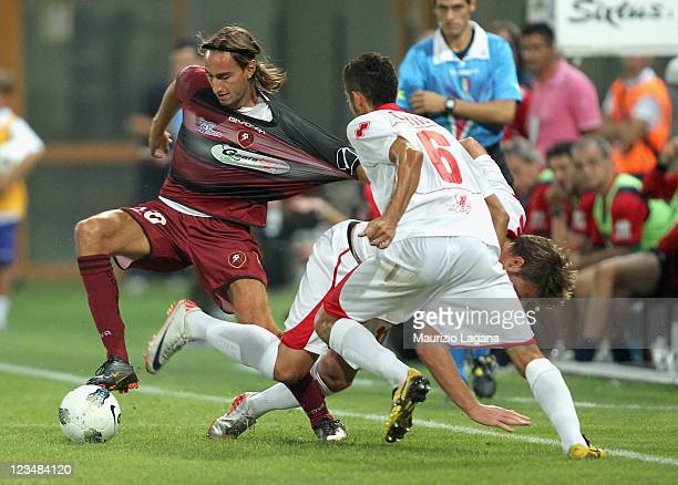 Simone Missiroli of Reggina competes for the ball with Marco Crimi of Grosseto during the Serie B match between Reggina Calcio and US Grosseto FC at...