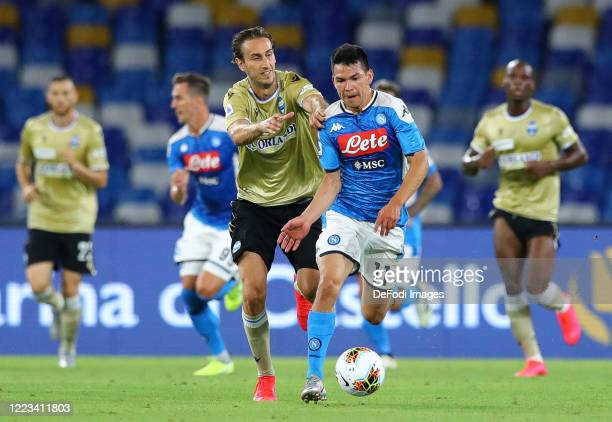 Simone Missiroli of SPAL and Hirving Lozano of Napoli battle for the ball during the Serie A match between SSC Napoli and SPAL at Stadio San Paolo on...