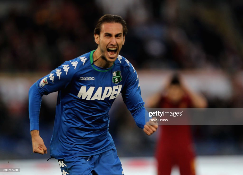 Simone Missiroli of US Sassuolo celebrates after scoring the team's first goal during the serie A match between AS Roma and US Sassuolo at Stadio Olimpico on December 30, 2017 in Rome, Italy.