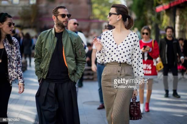 Simone Monguzzi wearing wide leg pants olive bomber jacket and Tako Chkheidze is seen during Tbilisi Fashion Week Spring/Summer 2018 on October 29...