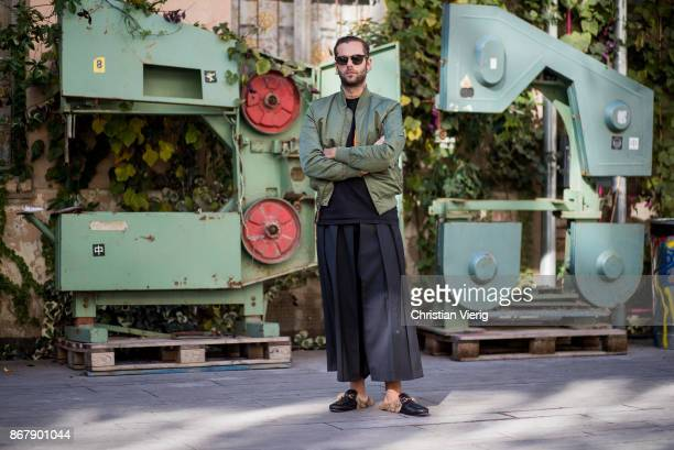 Simone Monguzzi wearing wide leg pants olive bomber jacket is seen during Tbilisi Fashion Week Spring/Summer 2018 on October 29 2017 in Tbilisi...