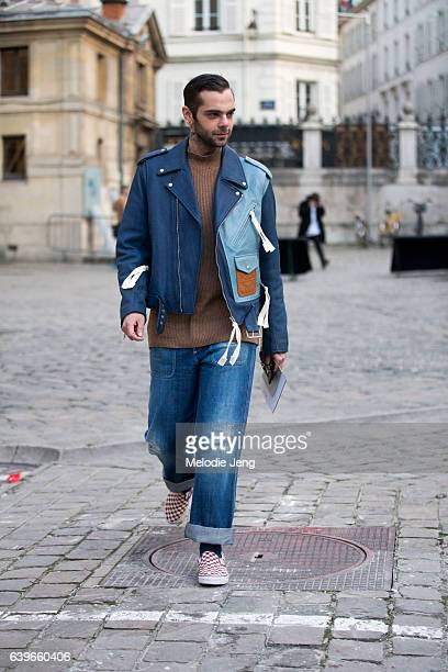 Simone Monguzzi wears a dualtoned blue suede Loewe jacket and jeans at the Paul Smith show on January 22 2017 in Paris France