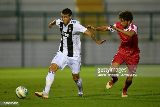 Simone Muratore of Juventus U23 is challenged during the Coppa Italia Serie C match between Juventus U23 and Cuneo at Moccagatta Stadium on August 21...