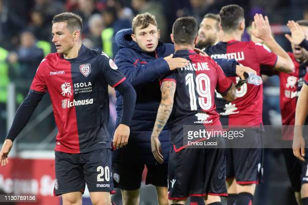 Simone Padoin and Fabio Pisacane of Cagliari celebrate victory at the end of during the Serie A match between Cagliari and ACF Fiorentina at Sardegna...