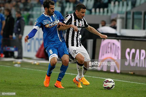 Simone Padoin and Riccardo Saponara during the Serie A match between Juventus FC and Empoli FC at Juventus Stafium of Turin on april 4 2015 in Turin...