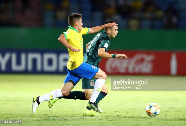 Simone Panada of Italy looks to break past Pedro Lucas of Brazil during the FIFA U-17 World Cup Quarter Final match between Italy and Brazil at the...