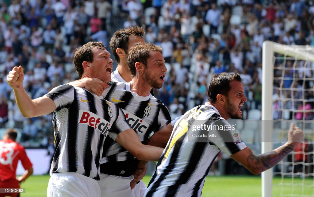 Simone Pepe of Juventus FC (R) celebrates scoring his team's second goal with team-matess Stephan Lichtsteiner (L) and Claudio Marchisio during the Serie A match between Juventus FC v Parma FC at Juventus Stadium on September 11, 2011 in Turin, Italy.