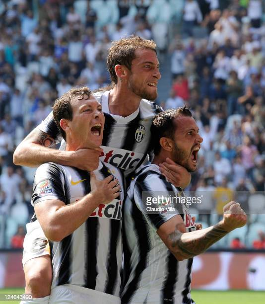 Simone Pepe of Juventus FC celebrates scoring his team's second goal with teammatess Stephan Lichtsteiner and Claudio Marchisio during the Serie A...